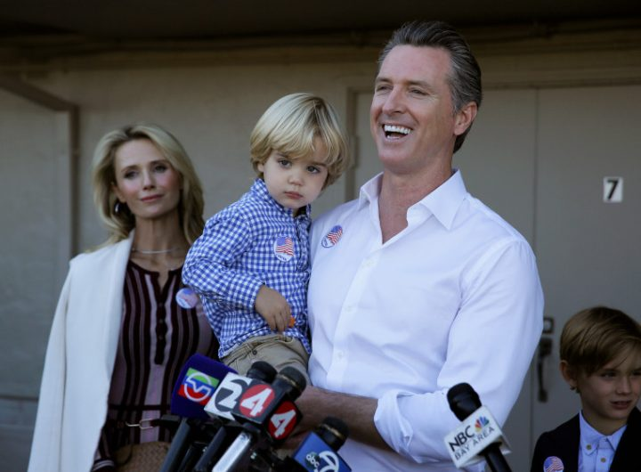 Photo: Governor Newsom, holding his son, Dutch, with  family as he speaks with reporters after his 2016 election day  victory. Photo Courtesy of Eric Risberg.